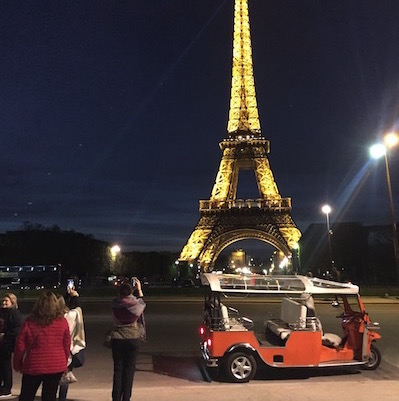 tuktuk at the eiffel tower by night